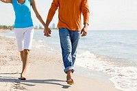 Close-up of a young couple walking on the beach