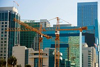 Crane in front of buildings, Miami, Florida, USA