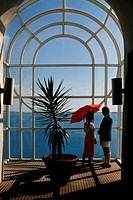 A couple is seen conversing near a plant, Bermuda portfolio, Bermuda