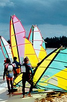 Small group of windsurfers gearing up for a competition, Nassau, Bahamas