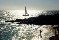 Side view of a sail boat sailing in a vast ocean , St. Martin, Caribbean