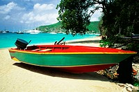 A boat is seen on a seashore on a sunny day, The Grenadines