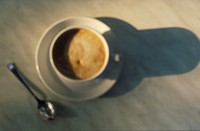 High angle view of a cup of coffee with a saucer and a spoon