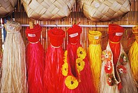 Grass skirt hanging at a market stall, Hawaii, USA