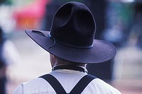 Rear view of a man wearing a cowboy hat