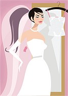 A woman trying on bridal gowns