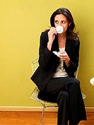 Businesswoman sipping cup of coffee