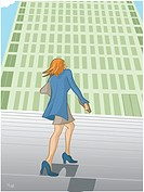A businesswoman walking up stairs towards a building