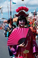 Woman, disguised, as, Asian, flower, parade, Battle, of, Flowers, St., Helier, Jersey, Channel, Islands, Great, Britain