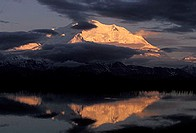 Alpen glow on 20320´ Mt McKinley contrasts with brooding clouds. Denali Nat´l Park, Alaska.