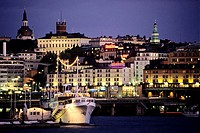 Illuminated architectural buildings at night, Slussen, Stockholm