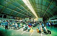 Passengers sitting at a railway station in Bangkok, Thailand