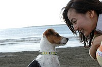Profile of pretty Asian woman and cute dog