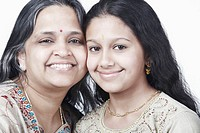 Portrait of a mature woman and her daughter smiling