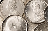 Close-up of Indian silver coins