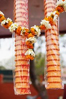 Close-up of ice-cream cones with a garland