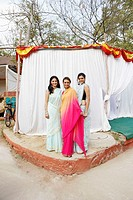 Portrait of three young women standing in front of a tent (thumbnail)