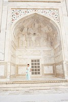Young woman standing in a mausoleum, Taj Mahal, Agra, Uttar Pradesh, India