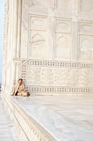 Young man sitting in a mausoleum, Taj Mahal, Agra, Uttar Pradesh, India