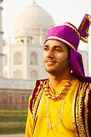 Close-up of a young man in front of a mausoleum, Taj Mahal, Agra, Uttar Pradesh, India