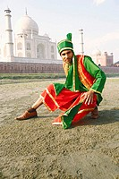 Portrait of a young man crouching on the riverbank, Taj Mahal, Agra, Uttar Pradesh, India