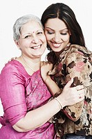 Portrait of a grandmother hugging her granddaughter (thumbnail)
