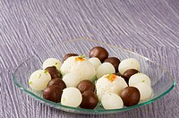 Close-up of Rasgullas and Gulab Jamuns in a bowl (thumbnail)