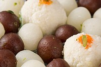 Close-up of Gulab Jamuns and Rasgullas