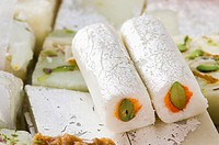 Close-up of Kaju roll with Kaju Katli