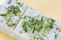 High angle view of Burfi garnished with Pistachios