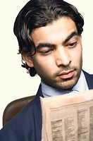 Close-up of a businessman reading a newspaper (thumbnail)