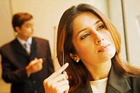 Close-up of a businesswoman thinking and holding a pen