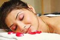 Close-up of a young woman lying on a massage table (thumbnail)