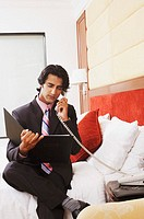 Businessman talking on the telephone and reading a file