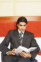 Close-up of a businessman reading a book