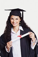 Portrait of a female graduate holding a diploma and smiling