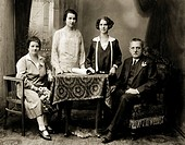 people, family, parents with children, group picture, cabinet picture, ca  1920, father, mother, two daughters, daughter, table, chair, armchair, sitt...