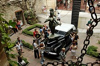High angle view of tourists near antique car in museum, Salvator Dali Museum, Figueres, Catalonia, Spain