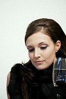 Close_up of young woman holding champagne flute