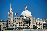Flags fluttering in front of church, St. Paul´s Cathedral, Malta