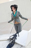Portrait of a businesswoman skipping with a jump rope