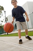 Low angle view of a boy playing basketball
