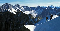 Team descends from the Aiguille du Midi, Alps, France  In the background: Aiguille Verte, Droites, Courtes, Triolet, and further behind: Dent Blanche ...