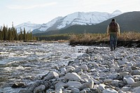 Man walking alongside a river