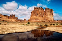 The Organ reflects in a temporary pool left by a passing storm, Arches National Park, Utah, USA