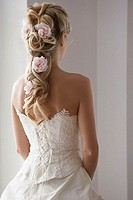 Bride wearing roses in her hair
