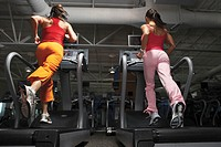 Women running on treadmills
