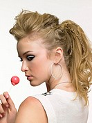 Teenage girl holding a lollipop
