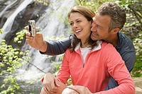 Couple taking a self portrait photograph