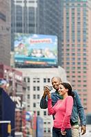 Couple using digital camera (thumbnail)